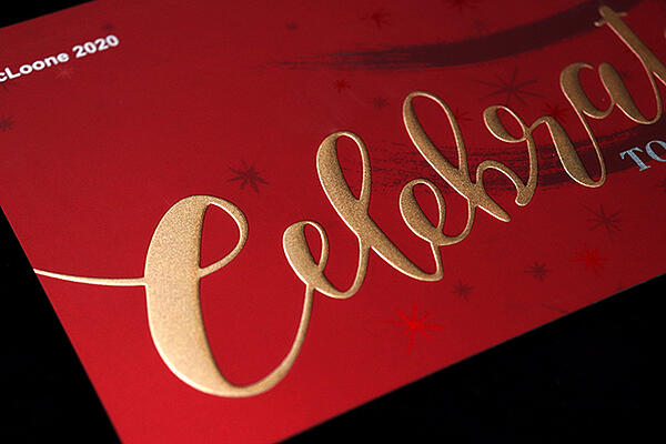 embossed graphics with metallic gold color on holiday card