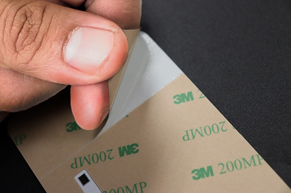 Common Adhesive Options for Nameplates and Labels