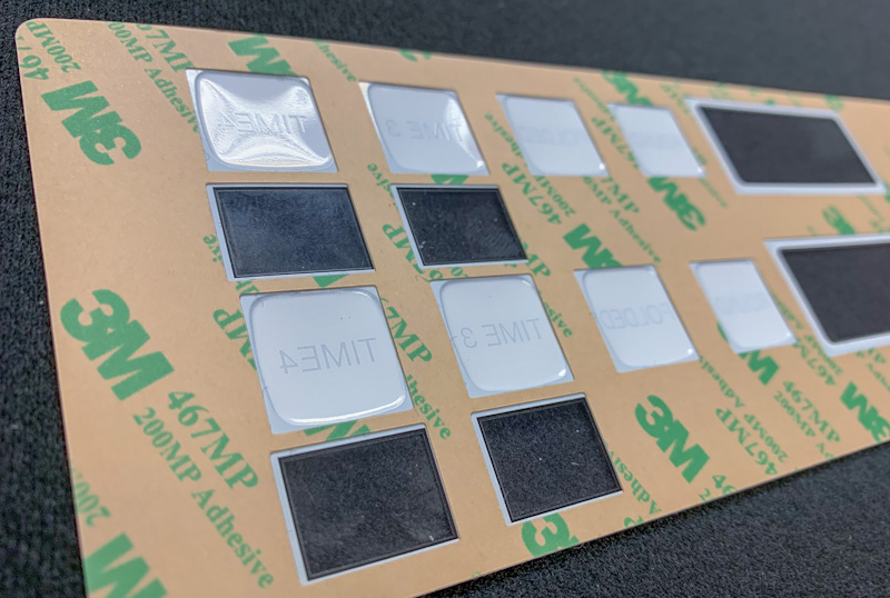 Area-Selective Adhesive Solutions for Control Panels and Graphic Overlays